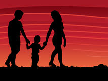 Family Walking. An illustration of a family walking on a sunset background Royalty Free Stock Images