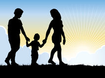 Family Walking. An illustration of a family walking on a sunrise background Royalty Free Stock Photo