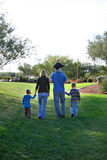 Family Walking. Attractive Family Walking at the Park royalty free stock photos