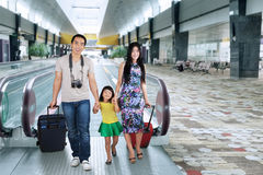 Family walking in the airport hall Royalty Free Stock Photo