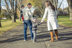 Family Walking Along Autumn Path Stock Images