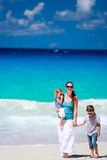 Family walking along the beach Stock Photography