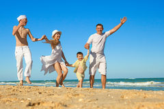 Family walking along the beach Stock Image