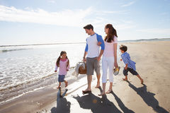 Family Walking Along Beach With Picnic Basket Royalty Free Stock Photo
