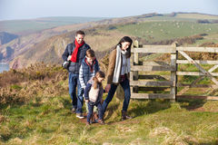 Family Walking Along Coastal Path Stock Photo