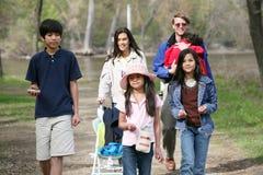 Family walking along country path Stock Photos