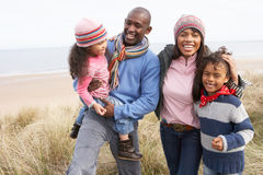 Family Walking Along Dunes On Winter Beach Royalty Free Stock Photography