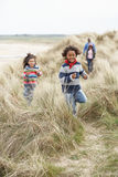 Family Walking Along Dunes On Winter Beach Royalty Free Stock Photos