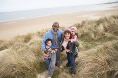 Family Walking Along Dunes On Winter Beach Royalty Free Stock Photo