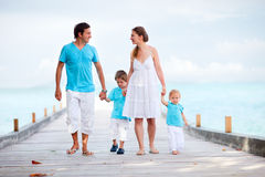 Family walking along jetty Royalty Free Stock Photo