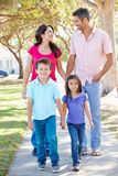 Family Walking Along Suburban Street Royalty Free Stock Image