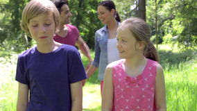 Family Walking Along Summer Woodland Path Together stock video