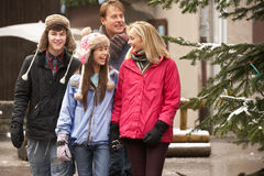 Family Walking Along Town Street In Ski Resort Stock Images