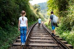 Family walking along train tracks Royalty Free Stock Photo