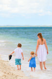 Family walking along tropical beach Stock Photography