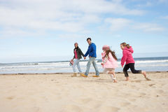 Family Walking Along Winter Beach Royalty Free Stock Photography