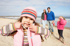 Family Walking Along Winter Beach Stock Images