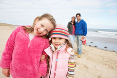 Family Walking Along Winter Beach Stock Photography