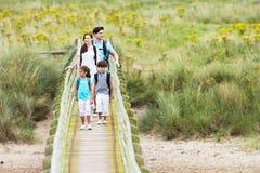 Free Family Walking Along Wooden Bridge Royalty Free Stock Photos - 33088618