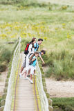 Family Walking Along Wooden Bridge Stock Image