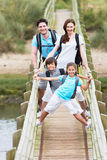 Family Walking Along Wooden Bridge Royalty Free Stock Photo