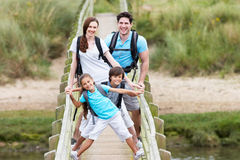 Family Walking Along Wooden Bridge Royalty Free Stock Photos
