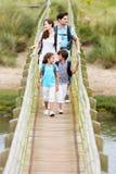 Family Walking Along Wooden Bridge Royalty Free Stock Images
