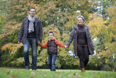 Family walking in apark royalty free stock images