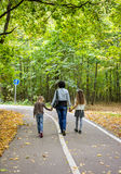 Family walking in autumn park Royalty Free Stock Images