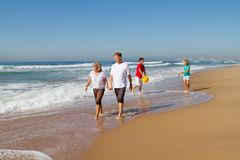 Family walking on beach Stock Image