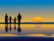 Family walking on beach Royalty Free Stock Photo
