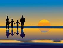 Family walking on beach Royalty Free Stock Photo