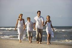 Family walking at beach. Stock Photo