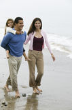 Family walking on beach royalty free stock images