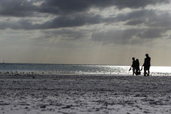 Family walking on the beach. Happy Family walking on the beach in Siesta Key Stock Photography