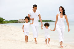 Family walking on a beach Stock Photos