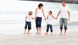 Family walking on a beach Royalty Free Stock Photos