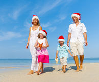 Family walking on the beach in Christmas Royalty Free Stock Images