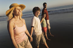 Family Walking On Beach At Dusk Stock Photos
