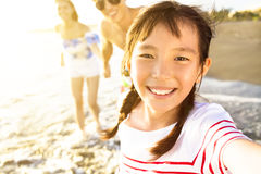 Family walking on the beach enjoy summer vacation. Happy family walking on the beach enjoy summer vacation Royalty Free Stock Images