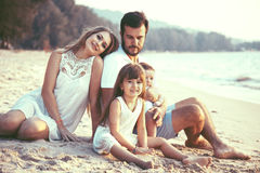 Family walking on the beach Royalty Free Stock Images