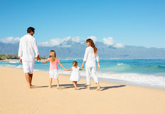 Family walking on the beach Stock Images