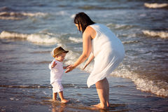 Family walking on the beach Royalty Free Stock Photos