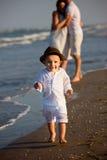 Family walking on the beach Stock Photos