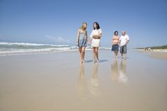 Family walking on beach holding hands Royalty Free Stock Images