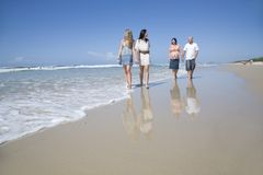 Family walking on beach holding hands Royalty Free Stock Photography