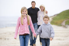 Family walking at beach holding hands. Smiling Stock Photo