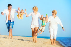 Family walking on the beach. stock photos
