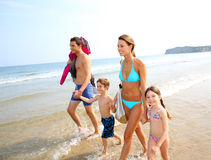 Family walking on the beach Royalty Free Stock Image
