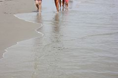 Family walking on the beach. On a sunny day in New York Royalty Free Stock Photos